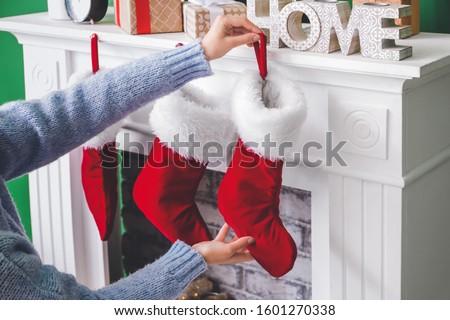 Stockings hanging on a female hand stock photo © GeniusKp