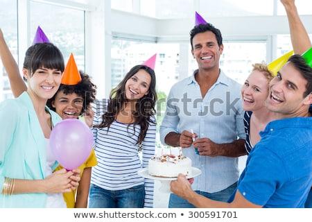 casual business team celebrating a birthday stock photo © wavebreak_media