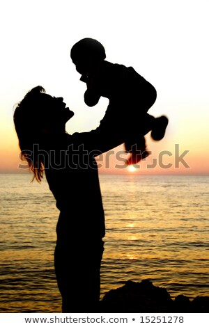 Mummy with baby on sunset at sea stock photo © Paha_L