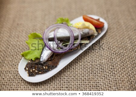 Delicious Spanish tapas with butter and onion salad sprat, Atlantic on slice baguette. An excellent  Stock photo © mcherevan