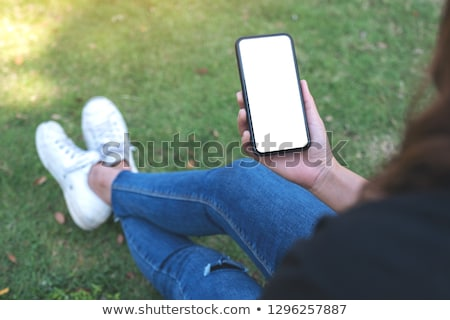 girl in the park with a telephone Stock photo © Giulio_Fornasar
