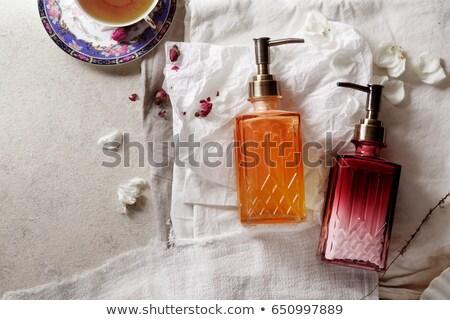 Iki kozmetik şişeler güller yaprakları şişe Stok fotoğraf © filipw