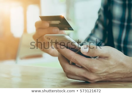 Debit card payment on mobile phone from home Stock photo © stevanovicigor