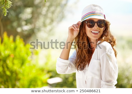 Portrait of a young attractive woman in summer hat Stock photo © deandrobot