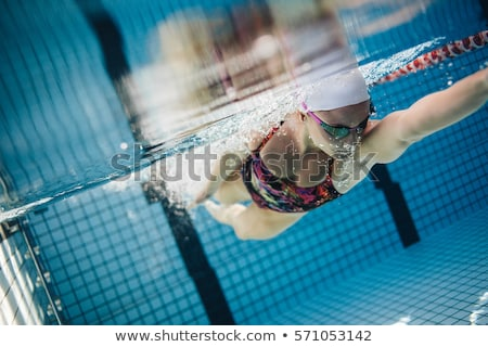 Woman Swimming, shot from underwater Stock photo © IS2