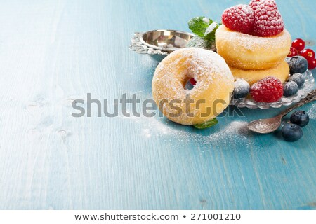 Morning breakfast with mini donuts and berries Stock photo © Melnyk