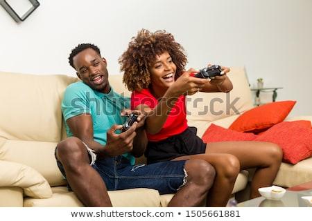 Mujer jugando videojuegos televisión palanca de mando casa Foto stock © AndreyPopov