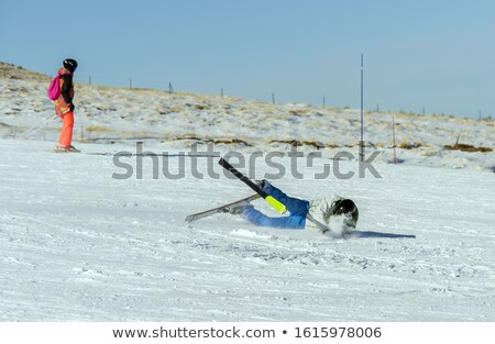 woman falling while doing cross country skiing stock photo © kzenon