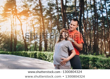 nice pregnant couple forest stock photo © lopolo