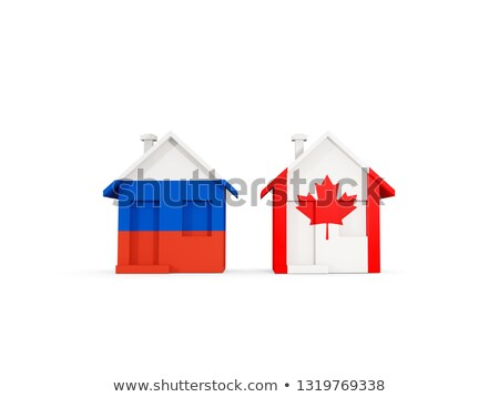 Two houses with flags of Russia and canada Stock photo © MikhailMishchenko