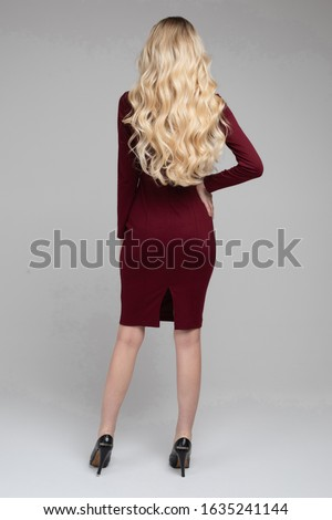 Stunning woman with perfect wavy blonde hair. Stock photo © studiolucky