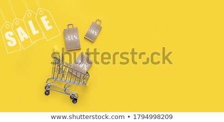 Online shopping concept. Online store objects and banner. People sitting on a big letters and using  Stock photo © makyzz