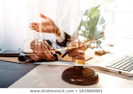 Attorney's suit, Law books, a gavel and scales of justice on a w Stock photo © Freedomz