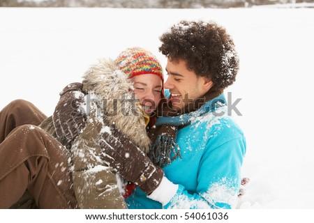 Romantyczny para śniegu człowiek Zdjęcia stock © monkey_business