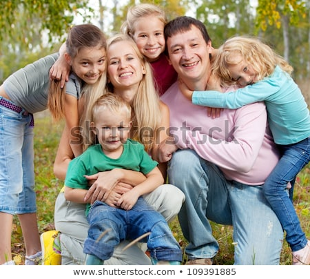 happy large family with children in autumn park stock photo © lopolo