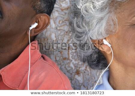 Zijaanzicht actief senior vrouw luisteren muziek Stockfoto © wavebreak_media