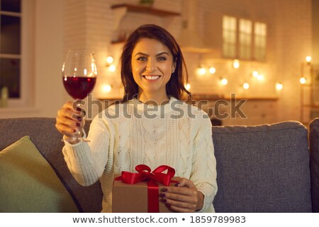Happy young brunette woman with glass of wine congratulating you on Christmas Stock photo © pressmaster