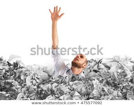 Businessman buried in crumpled papers Stock photo © nomadsoul1