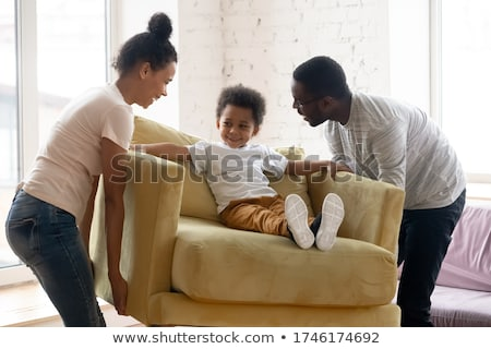 Happy husband and wife move in new bought house, buy furniture online, use modern technology, man su Stock photo © vkstudio