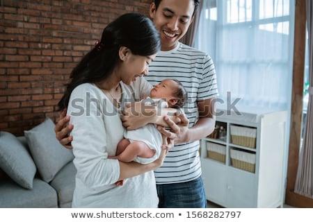 Baba küçük bebek kız ev aile Stok fotoğraf © dolgachov