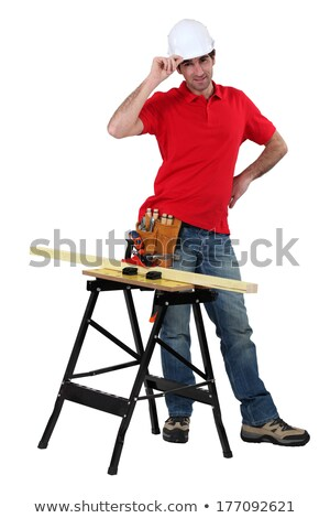 Carpenter stood with plank of wood on workbench Stock photo © photography33