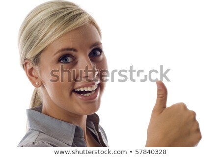 Gorgeous pretty girl showing thumbs up to you stock photo © stockyimages