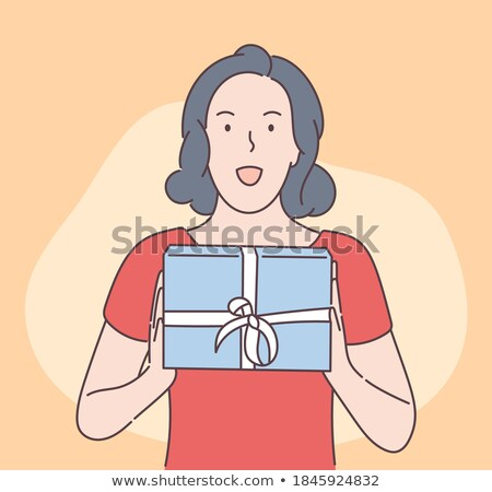 souvenir from the cute brunette to Christmas  Stock photo © OleksandrO