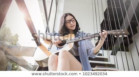 Asya kız gitar oynama şarkı söyleme şarkı Stok fotoğraf © leedsn