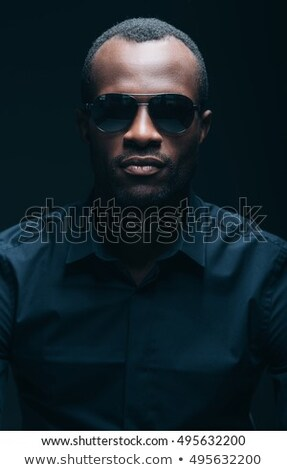 head man with sunglasses looking to the camera stock photo © feedough
