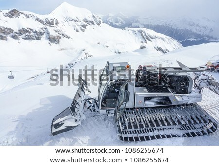 Modern red snow groomer in a sunny day Stock photo © CaptureLight