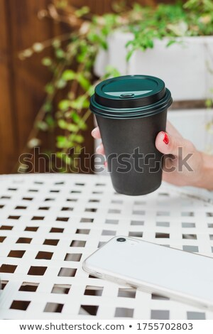 Cup of cappuccino on a wooden table against city view Stock photo © Nejron