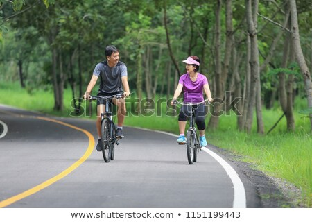 ázsiai · férfi · lovaglás · bicikli · park · vektor - stock fotó © rastudio