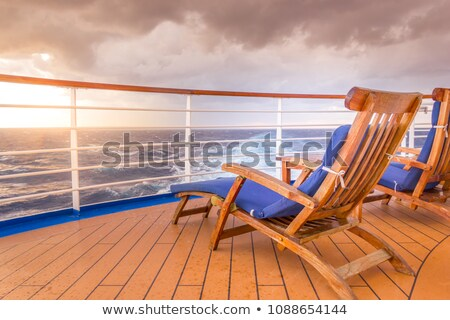 blue deck chair on a pier stock photo © nito