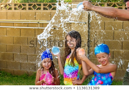 Children having a water fight Stock photo © bluering