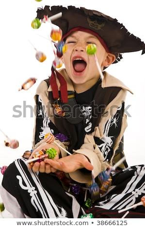 Smiling boy dressed as pirate Stock photo © acidgrey