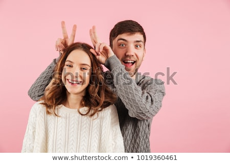 Portrait of a cheerful young couple dressed in sweaters Stock photo © deandrobot