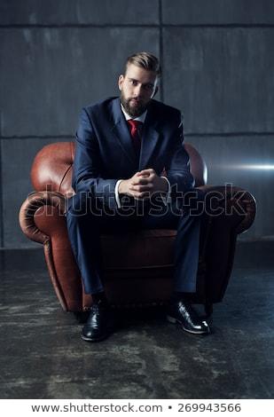 fiatal · elegáns · férfi · ül · néz · kamera - stock fotó © feedough