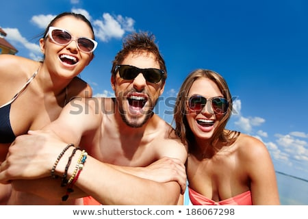 happy friends with beach and summer accessories stock photo © dolgachov