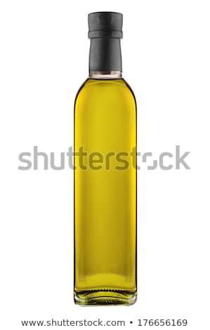 Zeytinyağı şişeler zeytin şube pişirme yağlar Stok fotoğraf © JanPietruszka