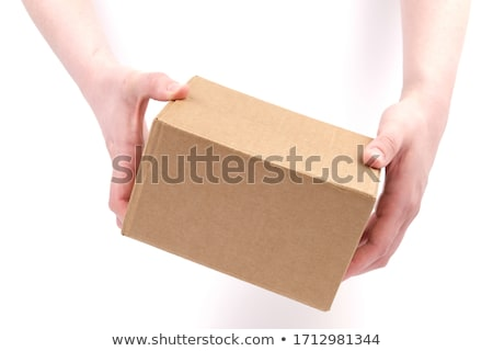 Delivery woman holding cardboard box Stock photo © choreograph