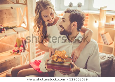 The young couple celebrating christmas at home Stock photo © Elnur