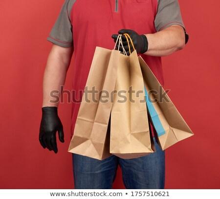 man wearing latex gloves carrying a shopping bag Stock photo © nito