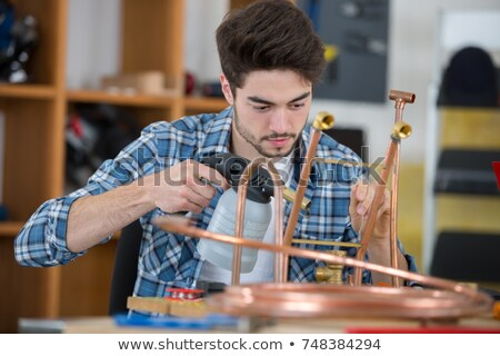 tradesman using a blowtorch stock photo © photography33