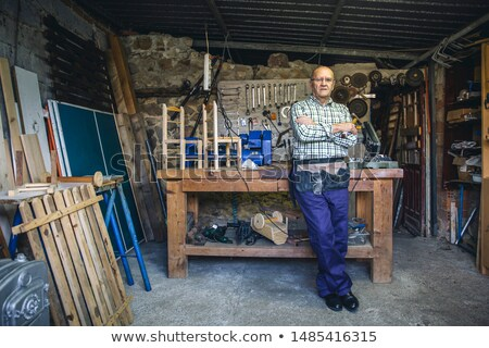 a carpenter posing with tools stock photo © photography33