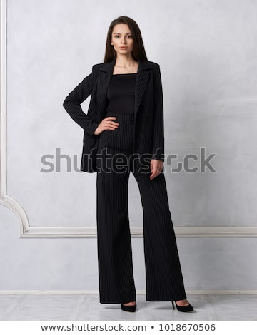 Portrait of graceful young brunette in black clothes Stock photo © acidgrey