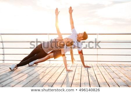Giovani famiglia yoga esercizio spiaggia donna Foto d'archivio © Geribody