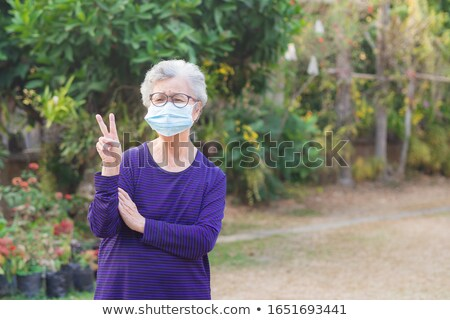 Kettő ujjak levegő kiemelt kéz férfi Stock fotó © stevanovicigor