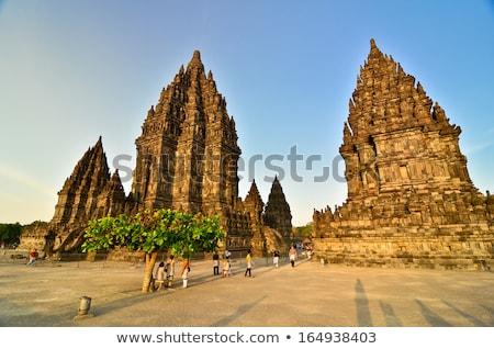Templo Indonésia silhueta nascer do sol sol reflexão Foto stock © dinozzaver
