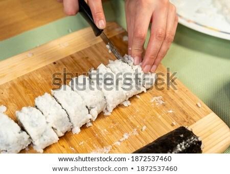 cook cuts the roll closeup  Stock photo © OleksandrO