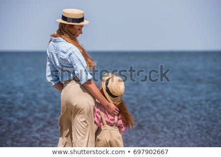 Parents with child stand on seacoast,  rear view Stock photo © Paha_L